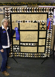 """Helen Belcher quilted """"Route 66,"""" First Place winner in the Pictorial Quilt Division at this year's HLSR"""