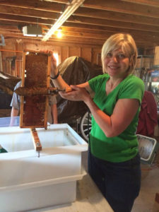 Dana Grant harvesting honey