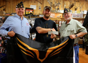 Area veterans present Ken with a check for the Lone Survivor Foundation