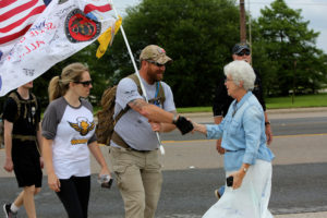 Charlotte Oleinik, founder of the H.E.A.R.T.S. Museum, greets Ken as he finishes this leg of his journey
